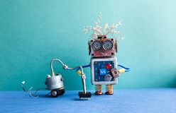stock image of  vacuum cleaner machine robot washer. automate cleaning room service concept. creative design toy cyborg, green blue