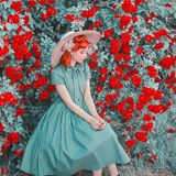 stock image of  valentines day background. stylish retro girl with red lips in dress on beautiful summer background. fashionable clothes.
