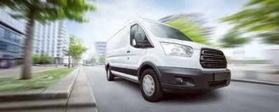 stock image of  van traveling in the city