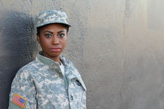 stock image of  veteran female african american soldier with neutral expression and copy space