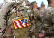 stock image of  veterans day. us soldiers arm. us army. us troops.