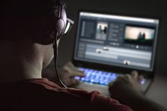 stock image of  video editing with laptop. professional editor.