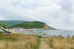 stock image of  view of the deserted beach on a cloudy summer day. bad weather does not interfere with people`s rest