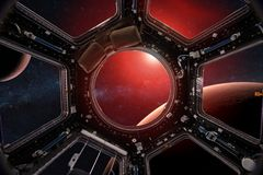 stock image of  view from a porthole of space station on the mars background.