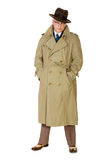 stock image of  vintage forties man in trenchcoat & trilby, isolated on white