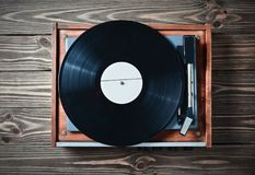 stock image of  vinyl player with plates on a wooden table. entertainment 70s. listen to music.