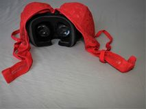 stock image of  virtual reality glasses for mobile devices with red underwear on top, vr technology is used for vr and adult entertainment.