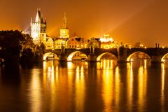 stock image of  vltava river and charles bridge with old town bridge tower by night, prague, czechia. unesco world heritage site