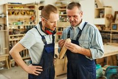 stock image of  carpenter teaching trainee