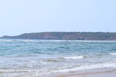 stock image of  ware beach - a serene and pristine beach in ganpatipule, ratnagiri, maharashtra, india
