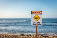 stock image of  warning: sharks sighted