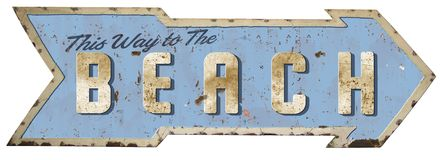 stock image of  this way to the beach tin sign