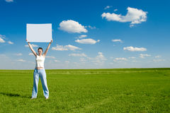 stock image of  woman with blank advert poster