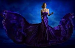stock image of  woman fashion dress, blue art gown flying waving silk fabric