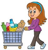 stock image of  woman with full shopping cart