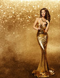 stock image of  woman gold dress, fashion model, champagne in long golden gown