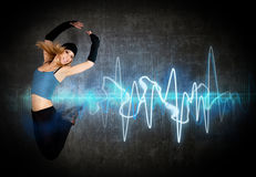 stock image of  woman jumping/dancing to the music rhythm