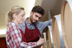 stock image of  woman and man checking ageing process wine