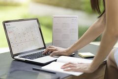 stock image of  woman planning agenda and schedule using calendar event planner.