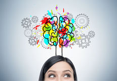 stock image of  woman s head, brain and cogs