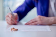 stock image of  the woman signing prenuptial agreement in court