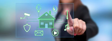stock image of  woman touching a digital smart home automation concept