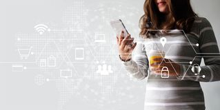stock image of  woman using mobile payments online shopping and icon customer network connection. digital marketing, m-banking and omni channel.