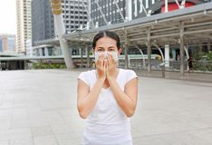 stock image of  woman wearing protective mask to protect pollution and the flu