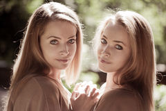 stock image of  women, twins in the forest