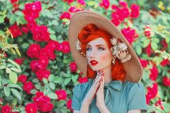 stock image of  wonderful retro girl in mint dress on beautiful summer background. stylish woman. fashionable summer clothes. young luxury redhead