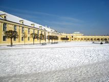 stock image of  lovely winter atmosphere with an austrian building in vienna next to the castle covered with snow