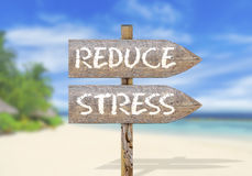 stock image of  wooden direction sign with reduce stress