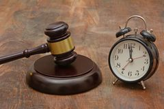 stock image of  wooden gavel with time clock delay justice concept