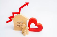 stock image of  wooden house and family with a red arrow up. concept of high demand for real estate. increase energy efficiency of housing. rise i