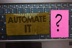 stock image of  word writing text automate it. business concept for convert process or facility to be operated automatic equipment. paperboard key