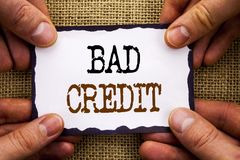 stock image of  word, writing, text bad credit. conceptual photo poor bank rating score for loan finance written on sticky note paper holding han
