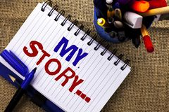 stock image of  word writing text my story.... business concept for biography achievement personal history profile portfolio written on notebook b