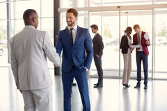 stock image of  worker at entrance shake hands with partner