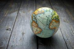 stock image of  world globe wood background