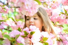 stock image of  wow. springtime. weather forecast. face and skincare. allergy to flowers. little girl in sunny spring. small child