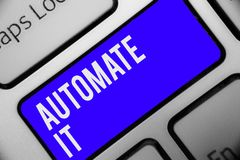 stock image of  writing note showing automate it. business photo showcasing convert process or facility to be operated automatic equipment. keyboa
