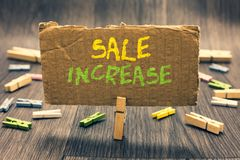 stock image of  writing note showing sale increase. business photo showcasing average sales volume has grown boost income from leads clothespin ho