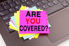 stock image of  writing question are you covered text made in office close-up on laptop computer keyboard. business concept for travel insurance h