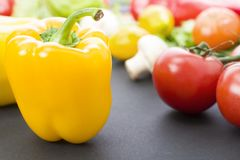 stock image of  yellow peppers on the table. yellow peppers are on the old table. dietary food. yellow peppers on a table on a background of veget