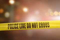 stock image of  yellow police line tape sign for protection crime scene