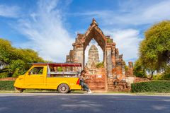 stock image of  young asian female traveler with backpack traveling sitting on taxi or tuk tuk and see map travel with old temple wat mahathat b