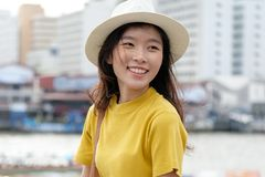 stock image of  young asian woman portrait smiling with happiness at city outdoors background, happy moment, casual lifesyle, travel blogger