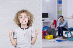 stock image of  young boy with bad mood