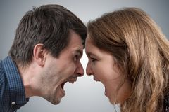 stock image of  young couple shouting each other. divorce concept