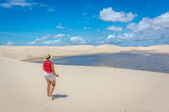 stock image of  young girl admiring the beauty of the lencois maranhenses, one of the main touristics destinations in brazil